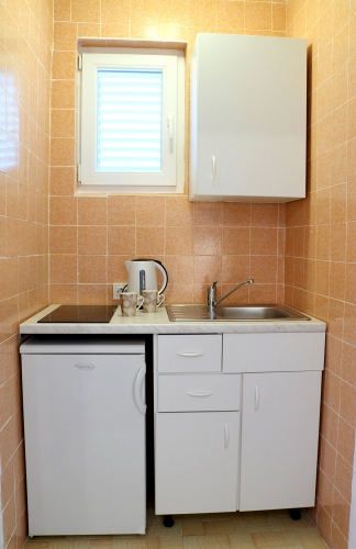 Jednokrevetna soba kuhinja